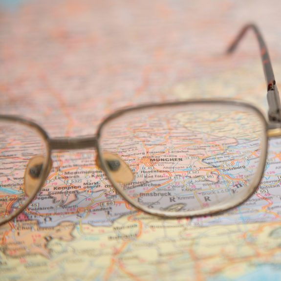 close-up of glasses on map