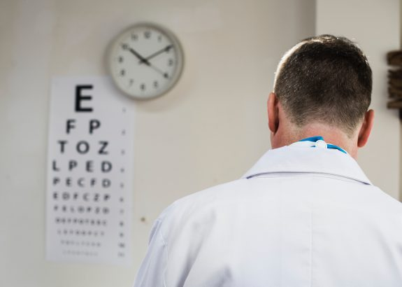 image of doctor in front of eye chart by rawpixel on unsplash